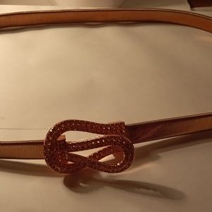 Rose gold tone elastic belt